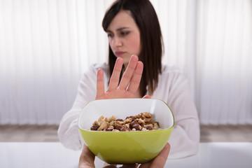 Woman Refusing Nut Food