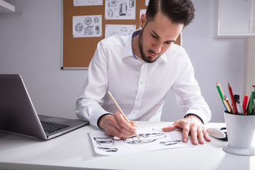 Artist Sketching On White Paper