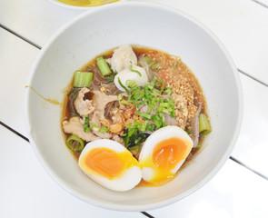 spicy thai noodles with eggs shot closeup