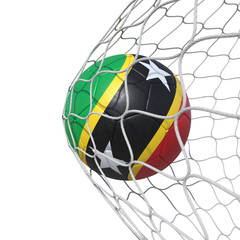 Saint Kitts and Nevis flag soccer ball inside the net, in a net.