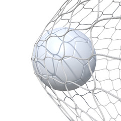 White clear leather soccer ball inside the net, in a net.
