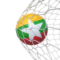 Myanmar flag soccer ball inside the net, in a net.