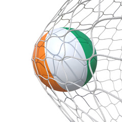 Cote d'Ivoire Ivorian flag soccer ball inside the net, in a net.