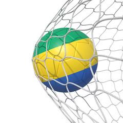Gabon Gabonese flag soccer ball inside the net, in a net.