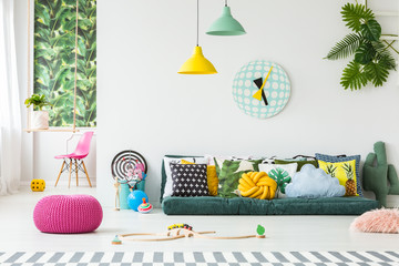 Pink pouf in bright interior