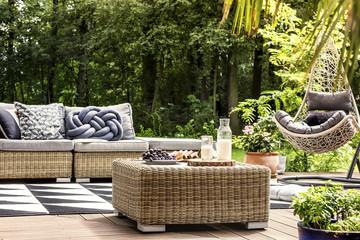 Wooden veranda with hanging chair