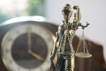Law symbols on bright background.