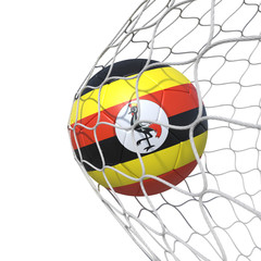 Uganda Ugandan flag soccer ball inside the net, in a net.