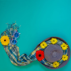 Summer background -  beach blue hat decorated with flowers