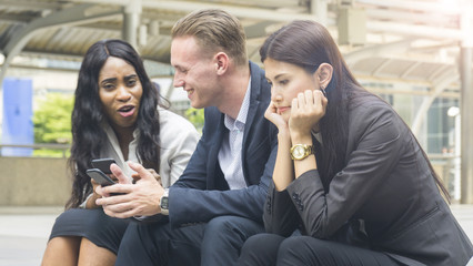 group people business use smart phone with woman feel stressed and disappointed and sit on stair