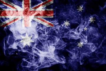 National flag of Australia from thick colored smoke on a black isolated background