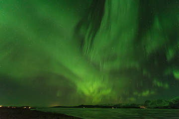 Aurora polaris above mountains.northern lights landscape