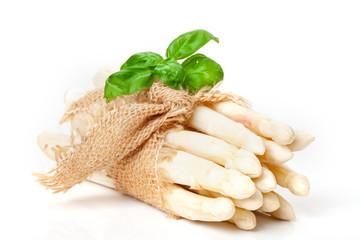 White asparagus, asparagus bunch in jute with Basil