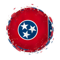 Round grunge flag of Tennessee US state with splashes in flag color.
