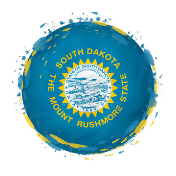 Round grunge flag of South Dakota US state with splashes in flag color.