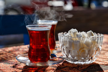 Turkish cups with hot tea and sugar