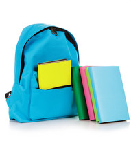 Backpack with school supplies, isolated on white background