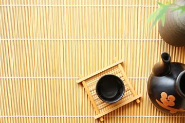 sake japanese oriental drink style on Bamboo mat