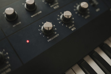 Detail of musical synthesizer keyboard and control buttons.