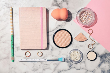 Flat lay composition with cosmetic products and notebook on light background