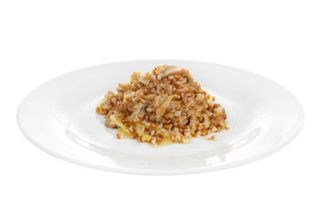 Buckwheat with onions and mushrooms fried, baked, cooked portion of side dish on a plate on white isolated background Side view. Appetizing dish for the menu restaurant, bar, cafe