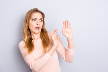 Impressed defend panicked people person feelings lifestyle impressed gesture concept. Portrait of shocked scared terrified big eyes woman trying to block herself with hands isolated on gray background
