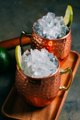 Close up of Moscow mule cocktail served in copper mugs