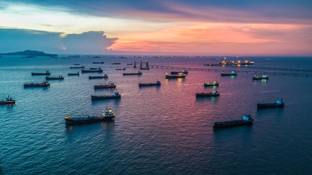 Aerial view tanker ship anchor parking in sea, Crude oil tanker ship and LPG tanker ship loading in bay at sunset, Bulk boat anchor.