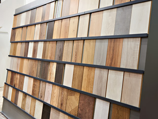 Samples of wooden laminate panels in store