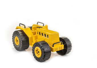 Yellow tractor toy for child on the white background