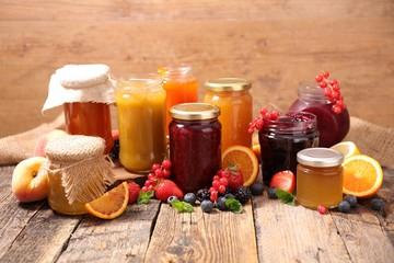 assorted jam on wood background