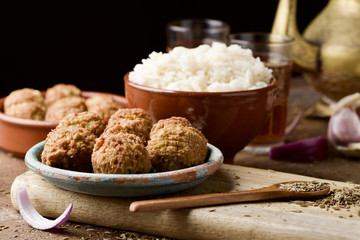 falafel and long grain rice on a wooden table