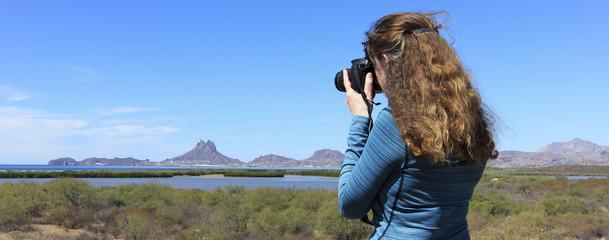 A Photographer Shoots Tetakawi Peak Rising Above San Carlos, the Sea of Cortez and Soldado Estuary