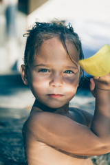 Portrait of a little girl standing in water