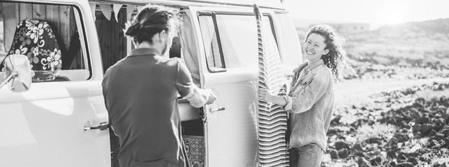 Happy surfer couple camping in road trip vacation in sunny day