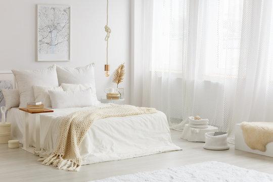 Beige blanket on white bed
