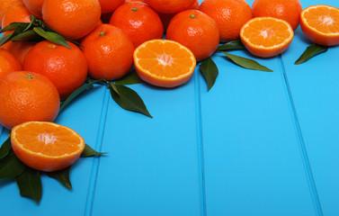 Orange on wooden background.