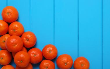 Tangerine on wood table.