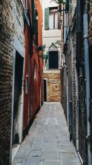 Narrow claustrofobic alley in Venice, Italy