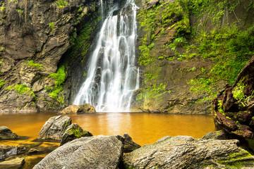 Photo Stands Roe Namtok (Waterfall) Khlong Lan in Khlong Lan National Park, Kamphaeng Phet, Thailand