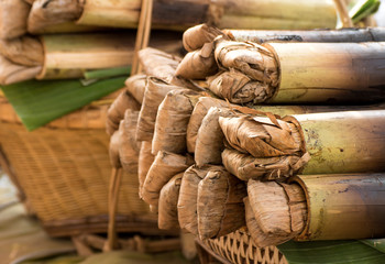 Glutinous rice roasted in bamboo joints (Khao lam or Kralan)