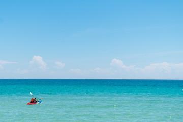 Couple love kayaking on sea