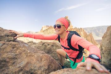 Woman hiker climbing mountains, weekend adventures