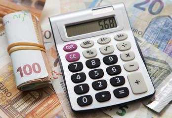argent billets de banque et calculette