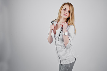Blonde sexy doctor nurse with stethoscope isolated on white background.