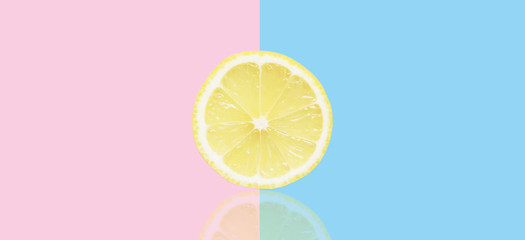 stock-photo-pink-and-blue-background-with-lemon-slice