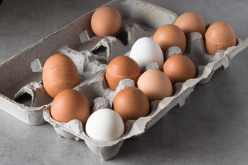 A carton of various eggs