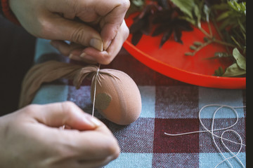 Woman hands decorating and painting easter eggs