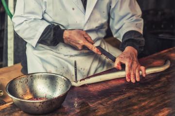 Japanese chef preparing Unagi fish for meal