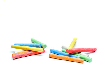 Multi-colored children's chalk isolated on white background.